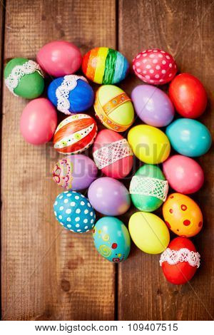 Decorated eggs on wooden table