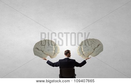 Back view of businessman sitting in chair and mind concept