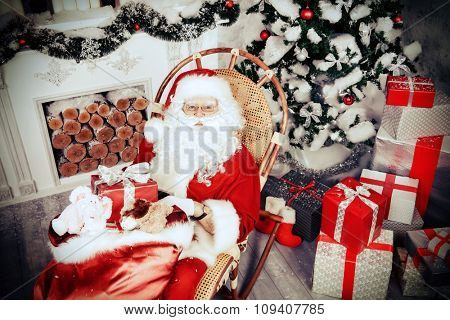 Jolly Santa Claus brought the sack with gifts. Christmas interior decoration. Merry Christmas. Retro style.