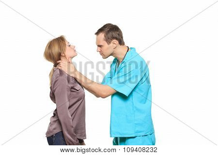 male doctor examines a female patient. isolated on white background