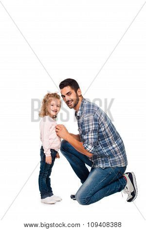 Father Arranging Backpack Of His Daughter