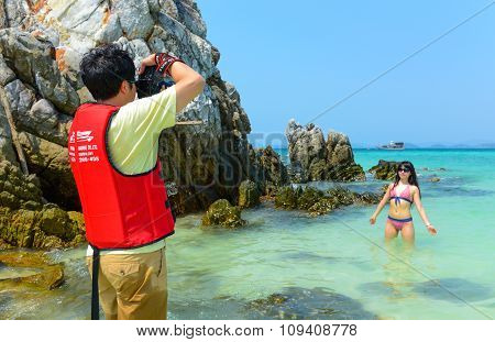 Beautifull Tourist Woman Poses For Photographers On The Beach