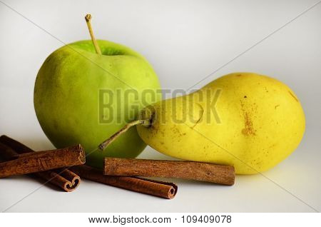 The Apple And Pear And Cinnamon Sticks