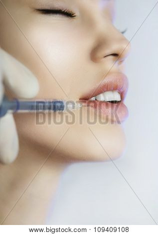 Woman Gets An Injection In Her Lips In Beauty Salon