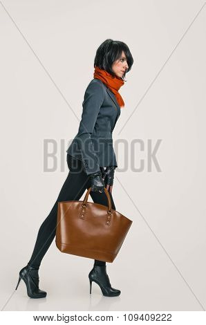 walking woman with bag