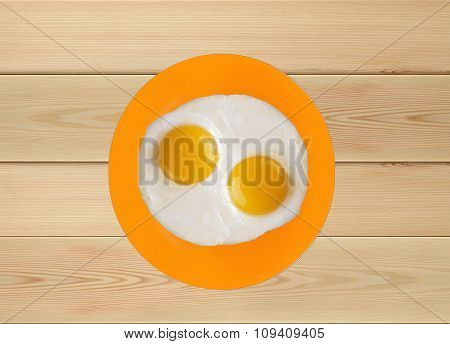 Two Fried Eggs On Orange Plate, Knife And Fork Isolated On White