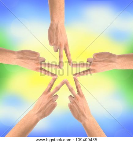 United Handsover Bright Nature Background. Conceptual Photo Of Teamwork