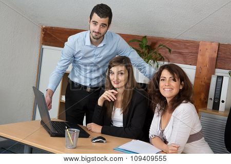 Business Teamof  Three Working On A Sales Results