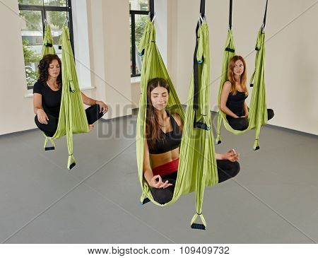 group women anti-gravity aerial yoga portrait