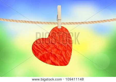 Crumpled Paper Heart Hanging On Rope Over Nature Background