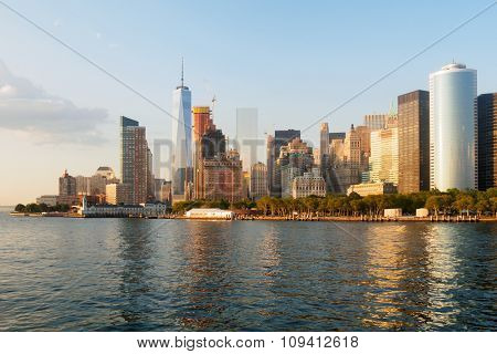The skyline of Lower Manhattan with reflections on the ocean