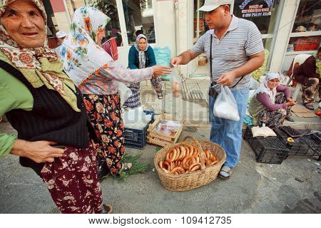 Customer Buying Traditional Bread Simit On Crowded Turkish Village Market