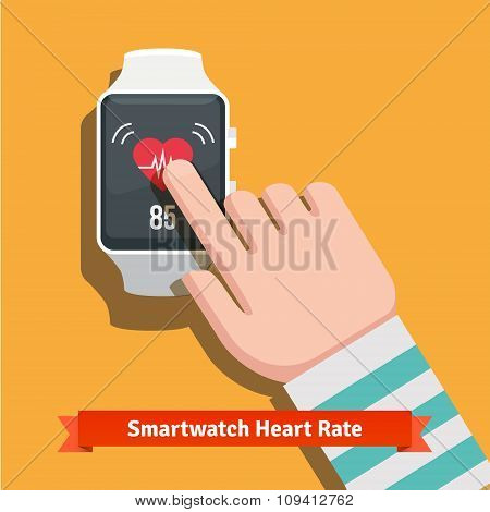White smart watch showing heart beat rate app