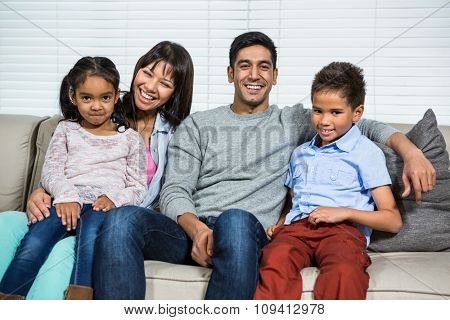 Happy family on the sofa posing for the camera
