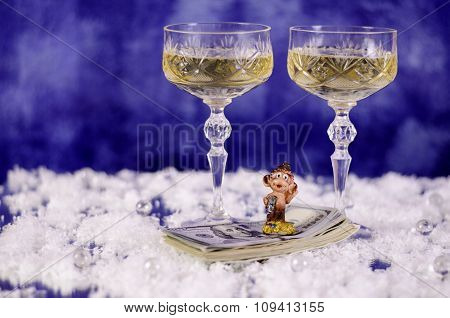 Christmas Glasses Of Champagne And A Monkey On The Dollar.