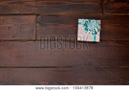 Gift Box On The Wooden Table