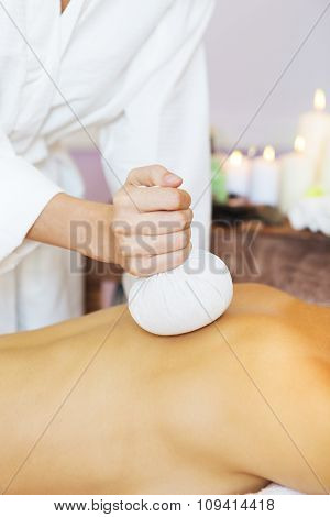 Beautiful Young Woman Having Back Massage With Pouch Of Rice