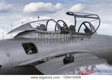 Detail of jet fighter aircraft with open cockpit