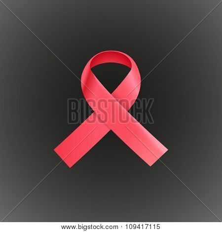 Pink ribbon on dark background. Breast cancer awareness