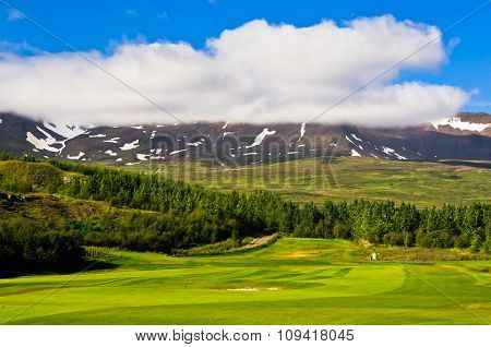Sunny summer day at golf course in Akureyri