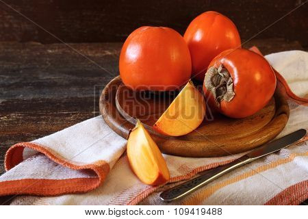Persimmon on a kitchen towel