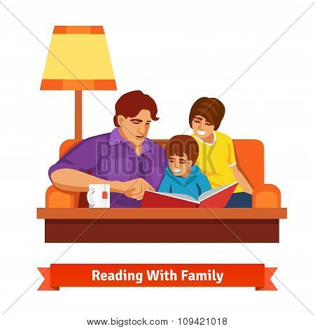 Happy family reading together. Mother, father, son