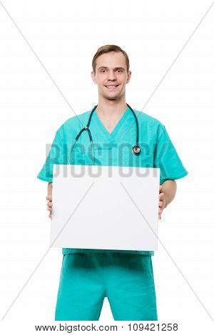 smiling doctor holding blank card isolated on white background