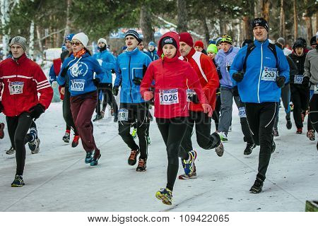 group athlete, young girls and men run group from start