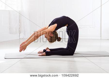 Beautiful Girl Doing Yoga Exercises
