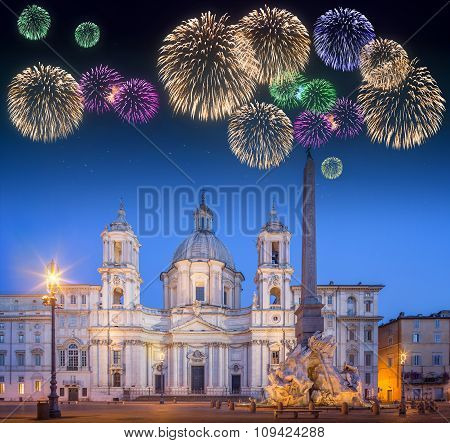 Beautiful fireworks under Four Rivers fountain and church Sant'Agnese