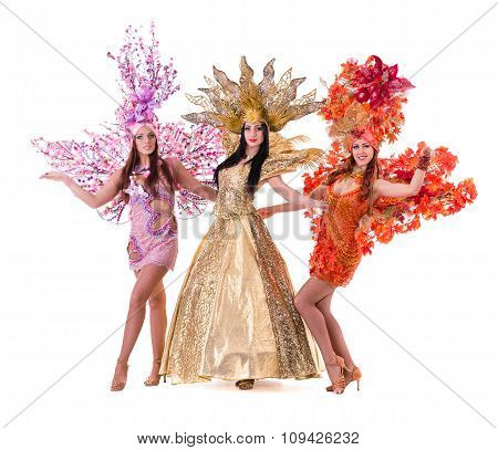 three carnival dancer women dancing against isolated white