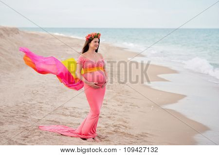 Smiling Pregnant Woman On The Beach