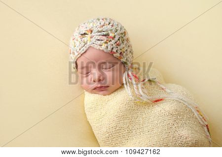 Sleeping Newborn Baby Girl Swaddled In Yellow