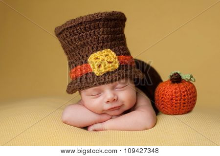 Smiling Newborn Baby Boy Wearing A Pilgrim Hat