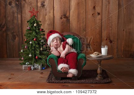 Newborn Baby Boy Wearing A Santa Suit