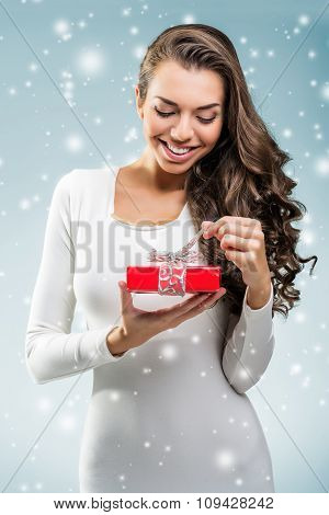 Woman surprised holding a red gift box