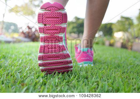 Woman Walking On Lawn