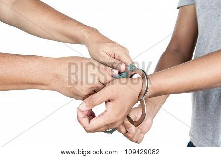 Closeup Of Unlocking A Shackle From Asian Male Hand, Isolated On White