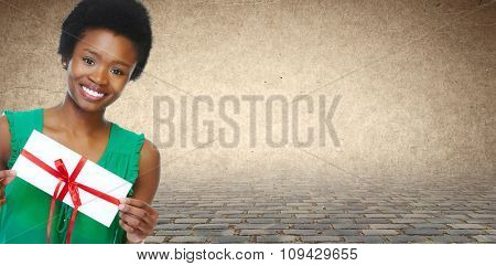 Young smiling African american girl with envelope.