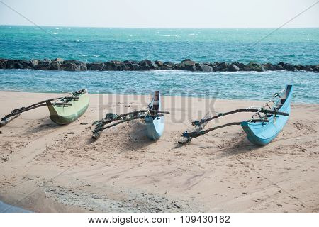 Three boats on beach Tangalle