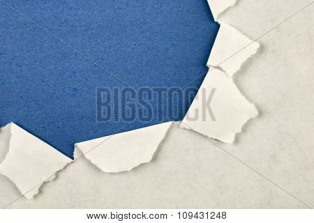 Ripped paper on blue background