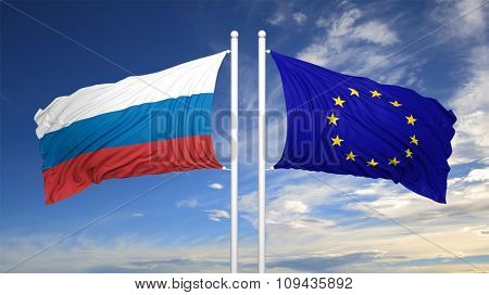 EU and Russian flags against of blue sky