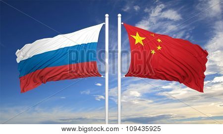Russian and Chinese flags against of blue sky