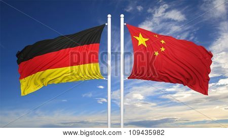 German and Chinese flags against of blue sky