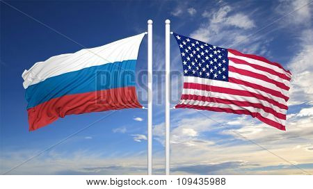 American and Russian flags against of blue sky