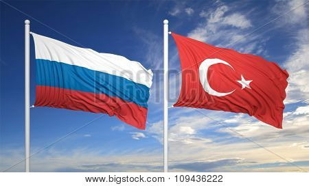 Turkish and Russian flags waving against of blue sky