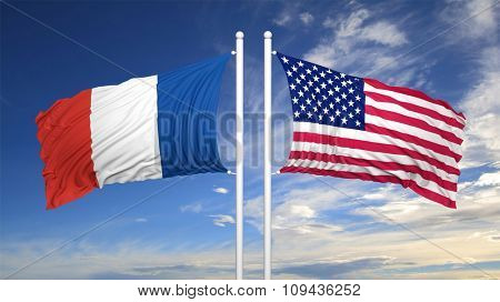 French and American flags waving against of cloudy sky