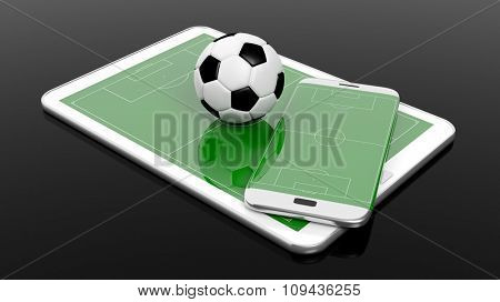 Soccer field with ball on smartphone edge and tablet display, isolated on black.