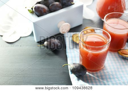 Plum Juice in a glasses with fresh fruits