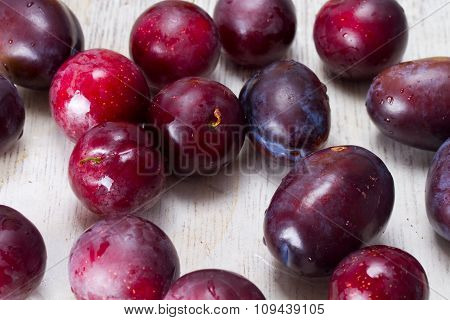 Ripe Plums And Cherry-plum On A Table